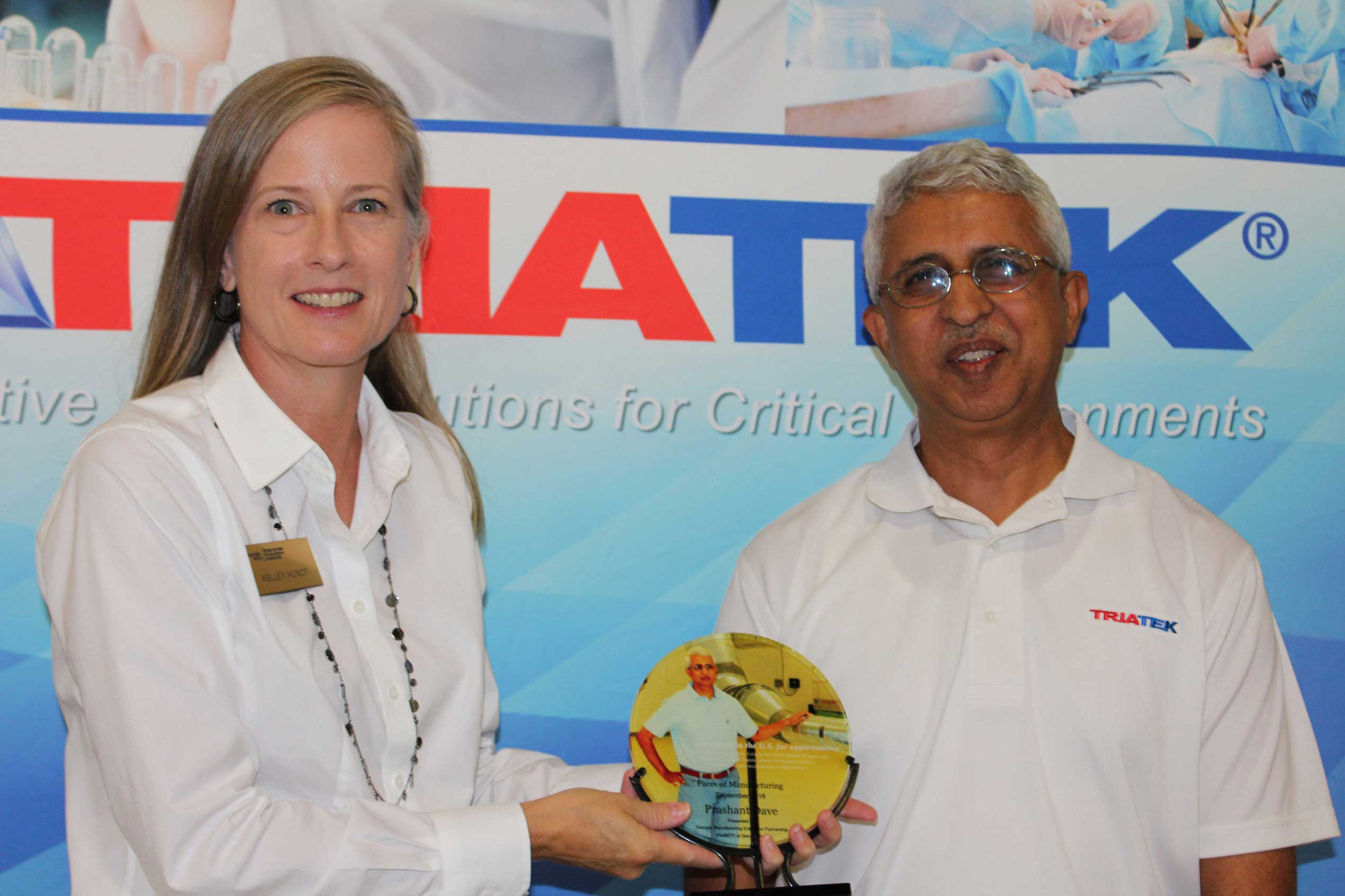 Kelley Hundt (left) of GaMEP presents the Faces of Manufacturing Award to Triatek's Prashant Dave