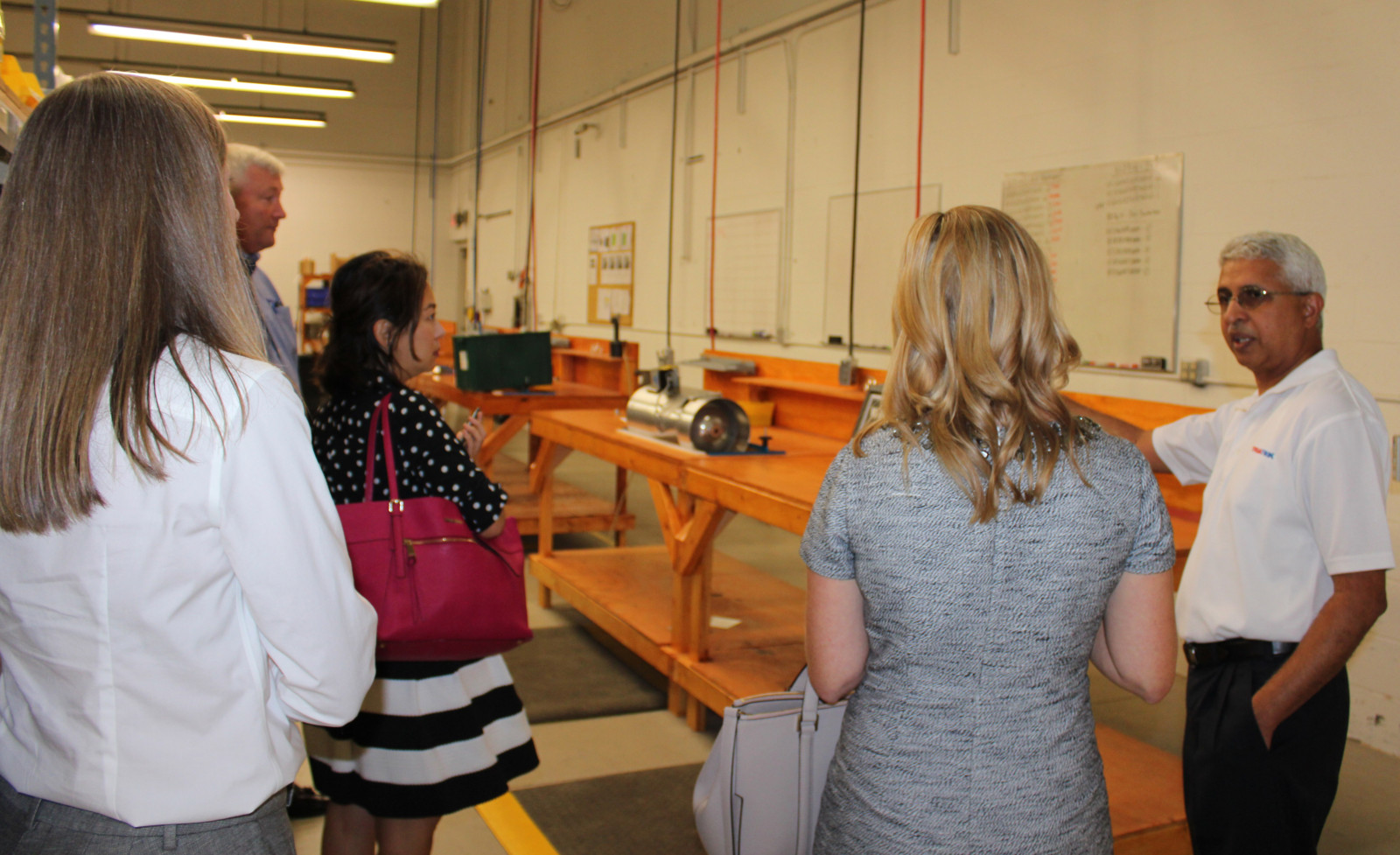 Prashant gives a tour of the Triatek facilities to members of the GaMEP and the Chamber of Commerce
