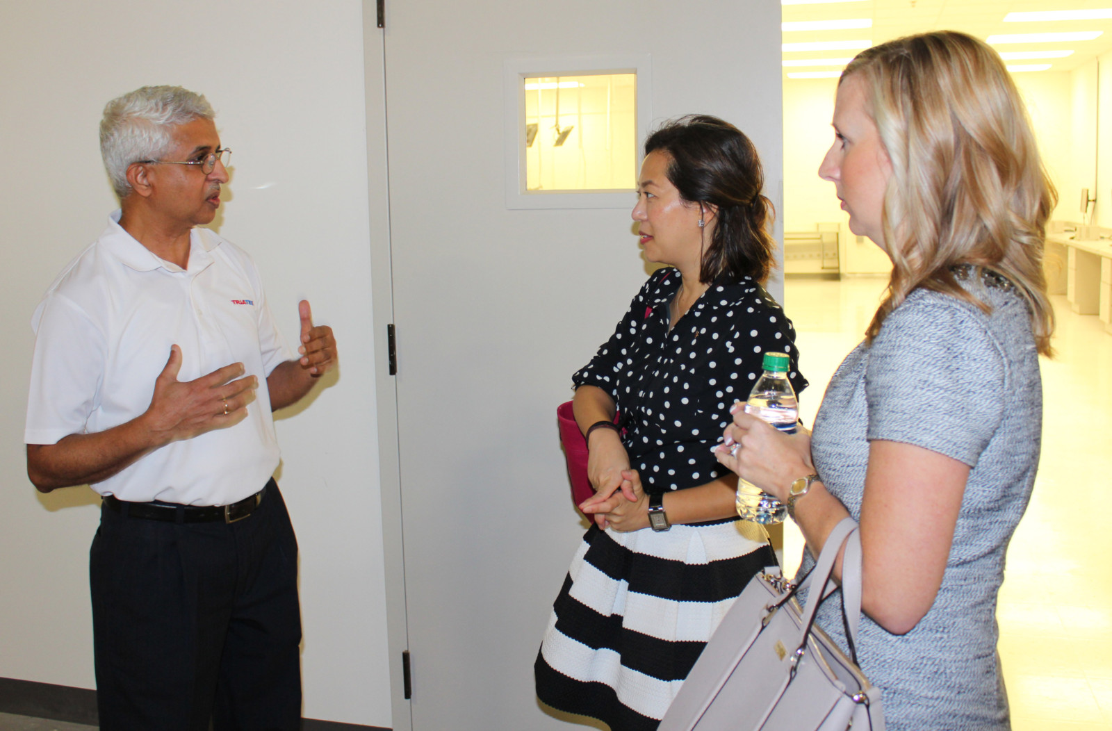 Prashant discusses manufacturing processes with representatives from the Chamber of Commerce